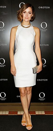 Rose Byrne got flirty in a cream halter dress with a glitzy pearl necklace and tan sandals.