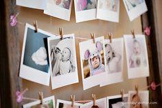 photos de bebe polaroid suspendu a un fil pour decoration