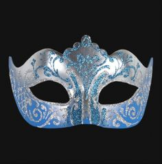 Stella Blue & Silver Venetian Masquerade Mask - Each hand finished mask might vary in decoration, adornments and style.This glittery ice queen mask is a cold and daring addition to your ensemble for your next masquerade party. The mask has beautiful silver swirls on the bottom of the mask and around the eyes like eyeliner. The insides of the eyes have a glittery blue sparkle as well as the top of the eyebrows and top the forehead in a squiggly faux tiara. #venetian #yyc #costume #mask