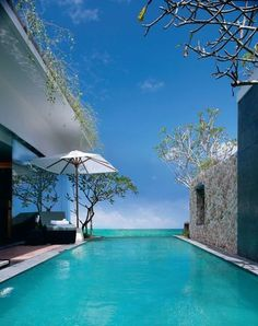 The pool villas at Anantara Uluwatu (Bali, Indonesia) ocean feature an infinity pool plain concrete with the color of the water merges with the sea