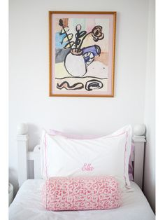 """""""I made the gold-framed painting above my bed in an art class when I was younger, and it adds an imaginative, childlike element to my room."""""""