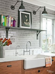 Like the sink Thoughtful finishing touches, including vintage-look swing-arm sconces, antique pulls, and an elegant high-arcing faucet, contribute a rustic-refined vibe. The eclectic mix of accessories keeps the industrial look from feeling too trendy. Industrial Kitchen Design, Rustic Kitchen, Vintage Kitchen, Kitchen Decor, French Industrial, Industrial Kitchens, Industrial Living, Country Kitchen, Industrial Style