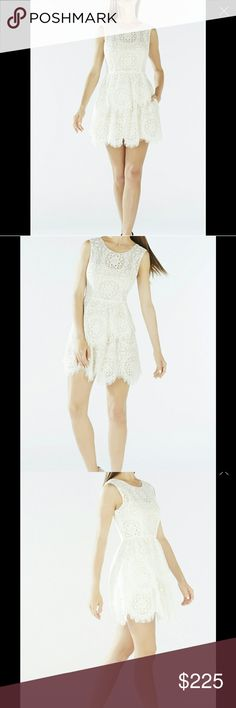 BCBG MAXAZRIA Charlee Dress Don this feminine lace silhouette for summer night chic. Color: ivory Round neckline. Sleeveless. Layered construction. Signature engineered circular floral block lace. Center back zipper with hook-and-eye closure. Center back keyhole with button closure. Asymmetrical hemline. Self: Cotton, Nylon, Rayon lace. Contrast: Polyester tulle. Lining: Polyester, Spandex. Dry Clean. This item is also listed on Vinted! 👗 BCBGMaxAzria Dresses