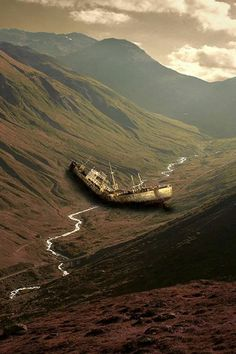 a broken, shipwrecked ship in a steep valley. an ocean is across the mountain, there is only a small river that appears like a creek beneath the ship. What is it doing there?