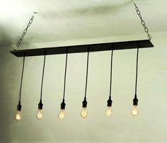 Really cool bar or dining light.  Salvaged hardwood floor with pendant lights and matte black powder finish brass hardware