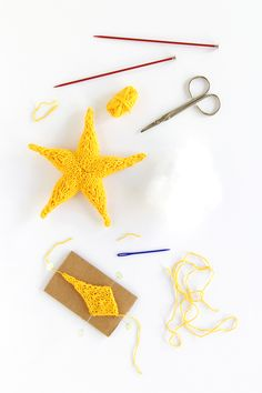 Knit this cute star ornament by Hands Occupied with Lion Brand Bonbons! Free knit pattern!