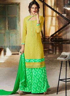 Buy salwar kameez online from an endless collection of latest salwar suit. Shop mystic print work designer palazzo suit for festival and party.