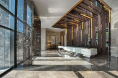 Marble covers almost every surface in this striking office lobby.  Pietra Grey features as the flooring of this interior, with white and black marbles applied on the reception desk and wall cladding.  For more beautiful marble surfaces visit www.rudischoice.co.za