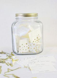 A glass jar full of slips of paper.