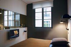 Une chambre cosy pour regarder la télévision au lit