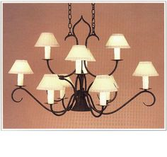 "7066  TEN LIGHT TWO TIER IRON CHANDELIER WITH DOWN LIGHT FABRICATED FROM ROUND STOCK FINISH SHOWN: INDIAN SUMMER SHADE: 3X7X4 WITH WHITE WAX CANDLES MAXIMUM WATTAGE: 600 CANDELABRA BASE SOCKETS DOWN LIGHT: 40 WATTS EDISON BASE SOCKET WITH  THREE CIRCUIT SWITCH HT 27"" W 41"" D 23"""