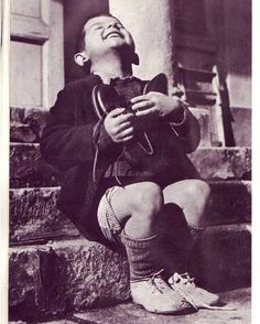Boy receiving a new pair of shoes at an orphanage in Austria, 1946.