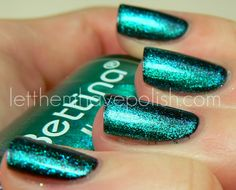"Bettina's ""Hustle"" from their Disco Collection. Awesome slightly duochrome shimmer. One coat layered on top of black (Onix). Wish list..."