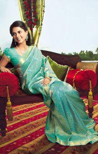 a evening wedding reception saree teal light blue green colored saree