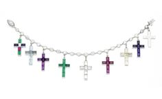The iconic cross bracelet composed of a chain of brilliant-cut diamonds to which the Duchess of Windsor attached nine gem-set Latin crosses between 1933 and 1944, each given to her by the Duke to mark the milestones of their life together. This cross bracelet included: nine platinum crosses set with calibrated gems including aquamarines, emeralds, rubies, yellow sapphires, amethysts and baguette-cut diamonds, all dated and bearing a personal inscription of a loving or secret nature on the…