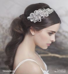 Silver-tone headpiece is expertly shaped to be worn on the right side and is delicately embellished with shimmering Swarovski crystals, pearls, seed beads and lined with lace.