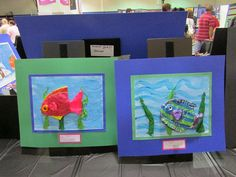 1st grade ceramic fish sculptures with painted background; lesson by art teacher: Susan Joe