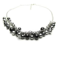 £45 ThisMirabella pearl necklace is perfect for the House of Colour winter palette, with pearlsof light grey, grey, dark grey and black Swarovski  pearls hung from a silver coloured chunky chain.  Any colour from the winter Swarovski pearl palette (see below) can be  chosen for this necklace, or a combination of up to four colours. Choose  them from the lists shown when you 'Add to cart'.  The necklace is approximately 45cm (18'') long with a short extender chain.  'Mirabella' means 'Of…