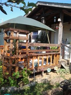 Grape arbor stained ; ) made out of pallets