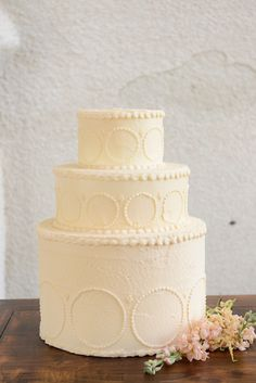White wedding cake with piping details