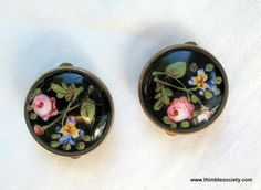 Pair of hand painted porcelain Bachelors buttons. Made for gentlemen who could not sew, the button works like a collar stud and secures the collar to shirt. English c.1860.    An inch across each button..FAVORITE!!!