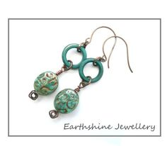 These earrings were inspired by my recent Greek Temple kit from The Curios Bead Shop. Teamed together with my own lampwork beads made using Effetre metallic copper green glass which has then been etched. The antique brass earwires are from Smitten Beads.