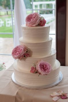 Simple wedding cake, adorned with pink roses -  We just love flowers as cake toppers! | Photo by www.salexphotography.com