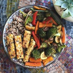 Wild rice, roasted balsamic veggies and pan fried tempeh with a little coconut amigos! This was soooo good my veggies came out perfect