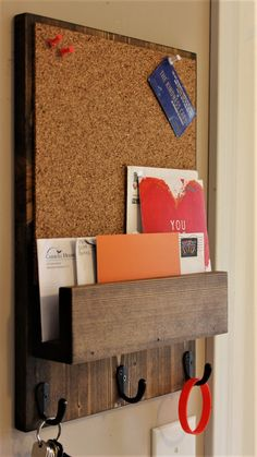 Go to this link to personalize your organizer. https://www.etsy.com/listing/495429850/personalized-option?ref=listing-shop-header-0 This mail organizer is perfect in rustic decor or country setting. Includes a cork board for posting notes 10-1/2 wide x 10-1/2 tall. 3 key hook holders.