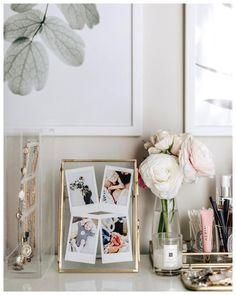 Gold frame, Polaroid, glass frame, ranunculuses, ranunculus, pretty flowers, vanity table, gold jewelry, #ranunculus #vanity #interiordesign #interiordesignideas #vanitytable Floating Frame, Floating Nightstand, Remain The Same, Interior Design Inspiration, Pretty Flowers, Gallery Wall, Vanity, Stripes, Ranunculus