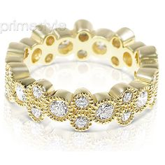 Present yourself with our luxuriant 14KT yellow gold diamonds eternity band. Composed with 1.70CT round cut breathtaking diamonds . This eternity band features exquisite diamonds of I-J color and, VS2-SI1 group clarity. Shine with elegance and simplicity with our 14KT yellow gold diamonds eternity band.