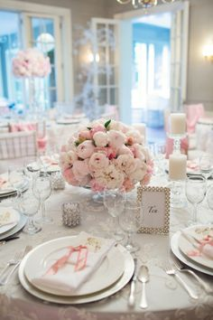 table setting weddin. flowers