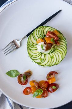 Raw, vegan summer lasagne.  Thinly sliced zucchini, cashew cheese and marinated avocados make for a great summer meal