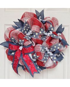 New, Full, Premium Handmade Deco Mesh wreath. Adorable, western cowboy themed wreath is made from white and red plaid deco mesh. This type of mesh is perfect for indoors or weather protected areas. Outer ring has solid denim colored ribbons which add fullness. The inner ring has adorable blue denim with white polka dot ribbons placed all about. A large denim blue with red bandana ribbons highlight the side wreath.