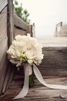 White bouquet maybe with mint green ribbon instead. Repin by Inweddingdress.com #bouquets