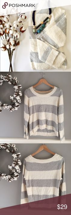 "NWOT LC Lauren Conrad Stripe Sweater Size M NWOT LC Lauren Conrad Striped Sweater Size M -- this can be your go-to neutral this fall. Wear it alone to be cozy chic or layer under a puffy vest or moto jacket. Ivory and grey stripes elevate a neutral color palette. Nylon / Acrylic blend and loose fibers all over make this the softest sweater you'll ever put on. Slight hi-lo hemline as seen in pic 2. 19"" bust, 20.5 length in front 24.5 in back. Size M LC Lauren Conrad Sweaters Crew & Scoop…"