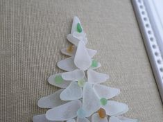 Christmas tree, Seaglass Christmas tree, Christmas decoration, multicolored christmas balls, White christmas, Frosted white sea glass. This Christmas tree is made of guenuine sea glass that I found on the beach at the edge of the Atlantic Ocean. This naturally polished sea glass (without