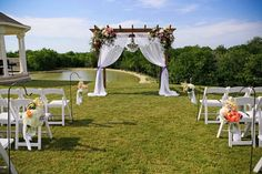 A simple arbor with some tulle draped on it.  Instead of flowers you could put lanterns or even a wreath of some type on each side.  That would help cut down on the cost.  Amazon has the one that Mom had for $149....And then you would have it for your yard to keep