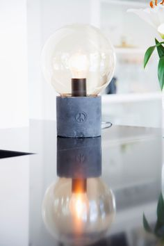 Concrete table lamp Peacebubble with a clear lamp deisgned by Åsa Gassle. Click the image and check other colors.    #sessakdesign #sessaklighting #sessak #lighting #sisustus #valaisin #new #newin #pöytävalaisin #interior #inredning #interior #Vintage #Modern #Minimalistic #Nature