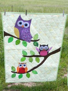 Cute Colorful Owl Baby or Toddler quilt on yellow with blue owls on the back featuring polka dots and flower & striped prints