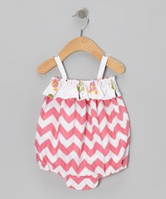 Charming with chevrons, this one-piece is footloose and fancy-free with its billowy silhouette, stretchy straps and contrast pattern ruffle up top. tumble dryMade in the USA Baby Bloomers, Petunias, Cute Babies, Diaper Bag, Chevron, Kids Fashion, Infant, Bubbles, Take That