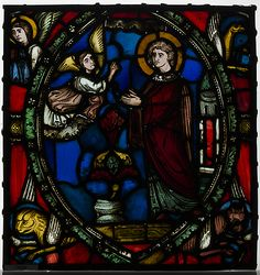 Stained glass fragment with an Angel Appearing to a Deacon Saint with the Symbols of the Four Evangelists 12th Century.  The Cloisters, Manhattan