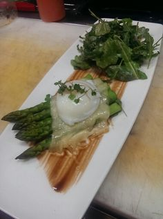 Asparagus with gruyere , 60 degree egg, rocket salad, and balsamic reduction.