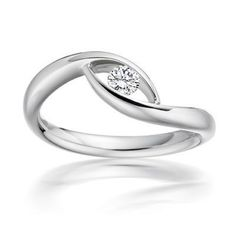 Paul Spurgeon // Single stone brilliant-cut diamond ring // Contemporary Engagement Rings and Diamond Jewellery