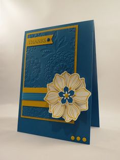 handmade card from CraftyCarolineCreates .... blue and golden yellow ... luv the embossing folder texture on the main panel ... interesting layout ... Stampin' Up!