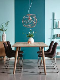 Turquoise wall, simple dining table and some cozy black chairs. And the lamp. Oh that lamp is perfect.