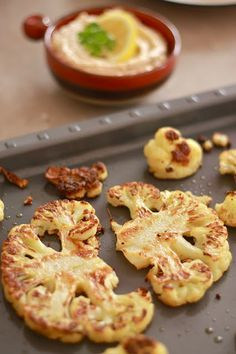 Roasted Cauliflower-this is a favorite in my house. I skip the sauce and just eat the cauliflower by itself! Uses no oil, only cumin and salt! SO good.