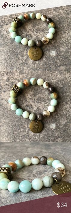Amazonite Charm Bracelet Earthy and charming Amazonite beaded charm bracelet with 10mm Amazonite beads, bronze accents, and a round bronze 'Live Laugh Love' charm! Lauren Alleyne Jewelry Jewelry Bracelets