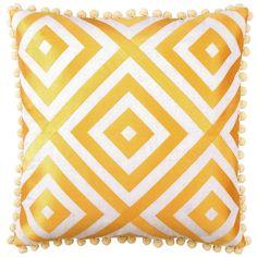 Yellow pillow with pom pom