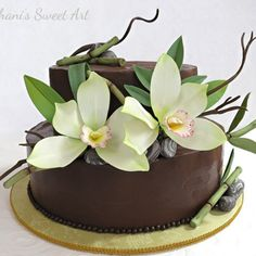 An Asian themed chocolate cake decorated with sugar orchids, rocks and bamboo made by Shani's Sweet Art